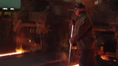 Portrait of Heavy Industry Worker Doing Quality Control in Foundry. - stock footage