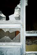 Close-up of broken windowpanes - stock photo