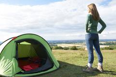 Woman Admiring View On Camping Holiday - stock photo