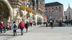 Cityscape of Munich. People walking over the Marienplatz. Camera pan Stock Footage