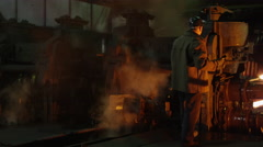 Heavy Industry Worker Doing Quality Control in Foundry. Industrial Environment.  Stock Footage