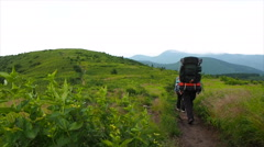 Backpacking in the mountains - stock footage