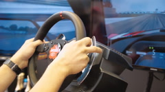 Young man, using a computer simulation for virtual racing, is very active drive Stock Footage