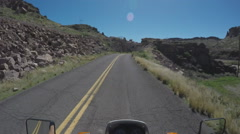 Motorcyclist Viewpoint On Narrow Curving Canyon Road In Desert - stock footage