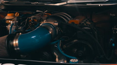 An internal combustion engine of a racing car - stock footage