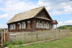 Very old wooden house in the remote Russian village in the summer - stock photo