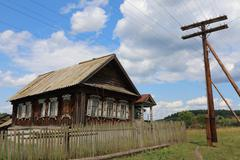 Stock Photo of Very old wooden house in the remote Russian village in the summer