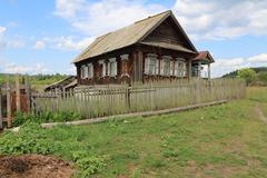 Very old wooden house in the remote Russian village in the summer Stock Photos