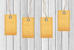 Brown tags on wooden background Stock Photos
