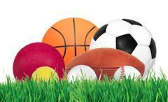 Sports balls over green grass isolated on white Stock Photos