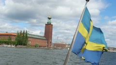 Ship with swedish flag leaving from old city, stockholm, sweden Stock Footage