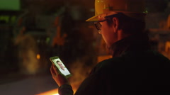 Foundry Worker in Hard Hat Have Video Call with Friend. Using Mobile Phone. Stock Footage
