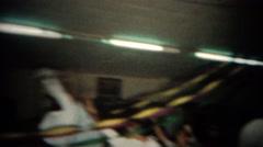 1965: Man garter belt toss to fighting men for the honor. BUFFALO, NEW YORK Stock Footage