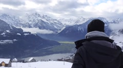 A young boy is capturing frosty Alps with his phone Stock Footage