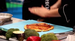 Chef cutting prepared pizza Stock Footage