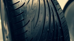 Closeup of various new tire tread Stock Footage