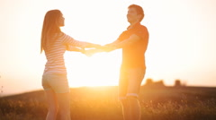 A handsome young guy turns the girl on the hand Stock Footage