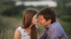 Beautiful young couple hugging in the mountains Stock Footage