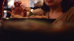 Woman in a restaurant eating sea food Stock Footage