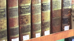 Old books stand on a cabinet in a specialized library, 4k Stock Footage
