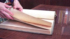Female hands thumb through old book library, 4k Stock Footage