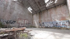 Kids explore an old abandoned building Tokamaru Bay, North Island New Zealand. Stock Footage