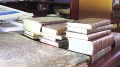 Old books on the table stack in a specialized library, 4k Stock Footage