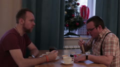 Two men sitting at table eating sushi Stock Footage