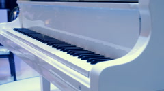 Keyboard of the brilliant white piano - stock footage