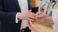 Bride And Groom Wear Wedding Rings - stock footage