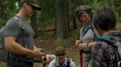 Hiking friends talk about their next hiking destination Stock Footage