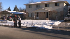 Firefighters and emergency services at house with carbon monoxide leak Stock Footage