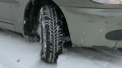 Tire on winter road , close-up Stock Footage