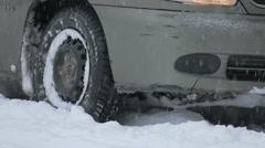 Wheel slip on snow, close-up Stock Footage