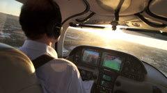 Airplane Pilot Navigating A Private Plane At Sunset View - stock footage