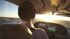 Pilot Navigating A Small Private Plane At Sunset View Stock Footage