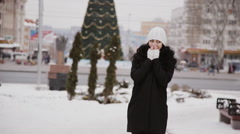 beautiful girl in the city on the background of Christmas tree - stock footage