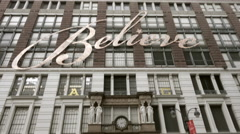 Macy's department store holiday season Christmas decoration believe sign 4K NYC - stock footage