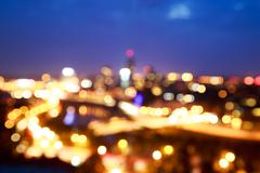City Lights at Night. Blurred Photo with Bokeh. - stock photo