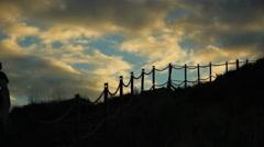 Hiking sunset Scotland Kings Seat Stock Footage