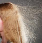 Stock Photo of Closeup of woman with static blonde hair.