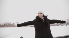 happy girl on a snow-covered bridge on - stock footage