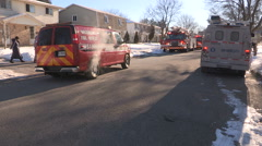 Firefighters and emergency services at house with carbon monoxide leak - stock footage