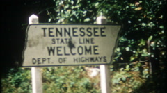 Tennessee State line boundary marker on highway - 3076 vintage film home movie Stock Footage