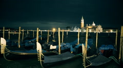 Night shot of gondolas at piazza san marco, venice Stock Footage
