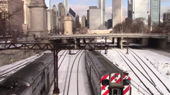 Chicago train cars pulling into the city, with snowy skyline - stock footage