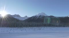 4k Beautiful Mountain Scenery Snow Trees Icy Peaks Jasper Sunlight Lens Flare - stock footage