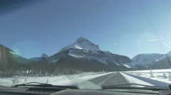 4k Car Windshield View Driving Jasper Snow Covered Mountains Hand Held Stock Footage