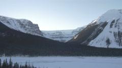 4k Beautiful Mountain Scenery Glacier Frozen Lake Snow Trees Forest Peaks Jasper Stock Footage