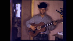 Young Man Playing County Western Guitar Vintage Film Home Movie 9240 Stock Footage